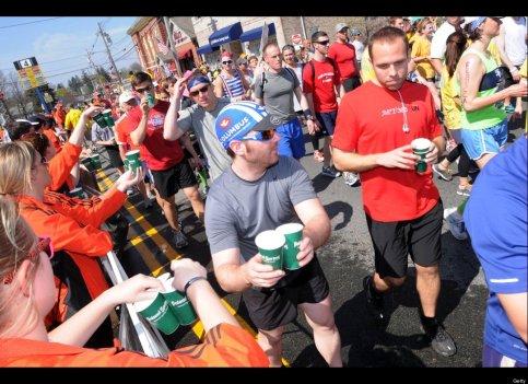 Runners stopping for water during the 2012 Boston Marathon. Photo: hunffingtonpost.com